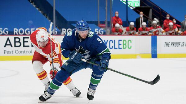 Игровой момент матча НХЛ Ванкувер Кэнакс - Калгари Флэймз