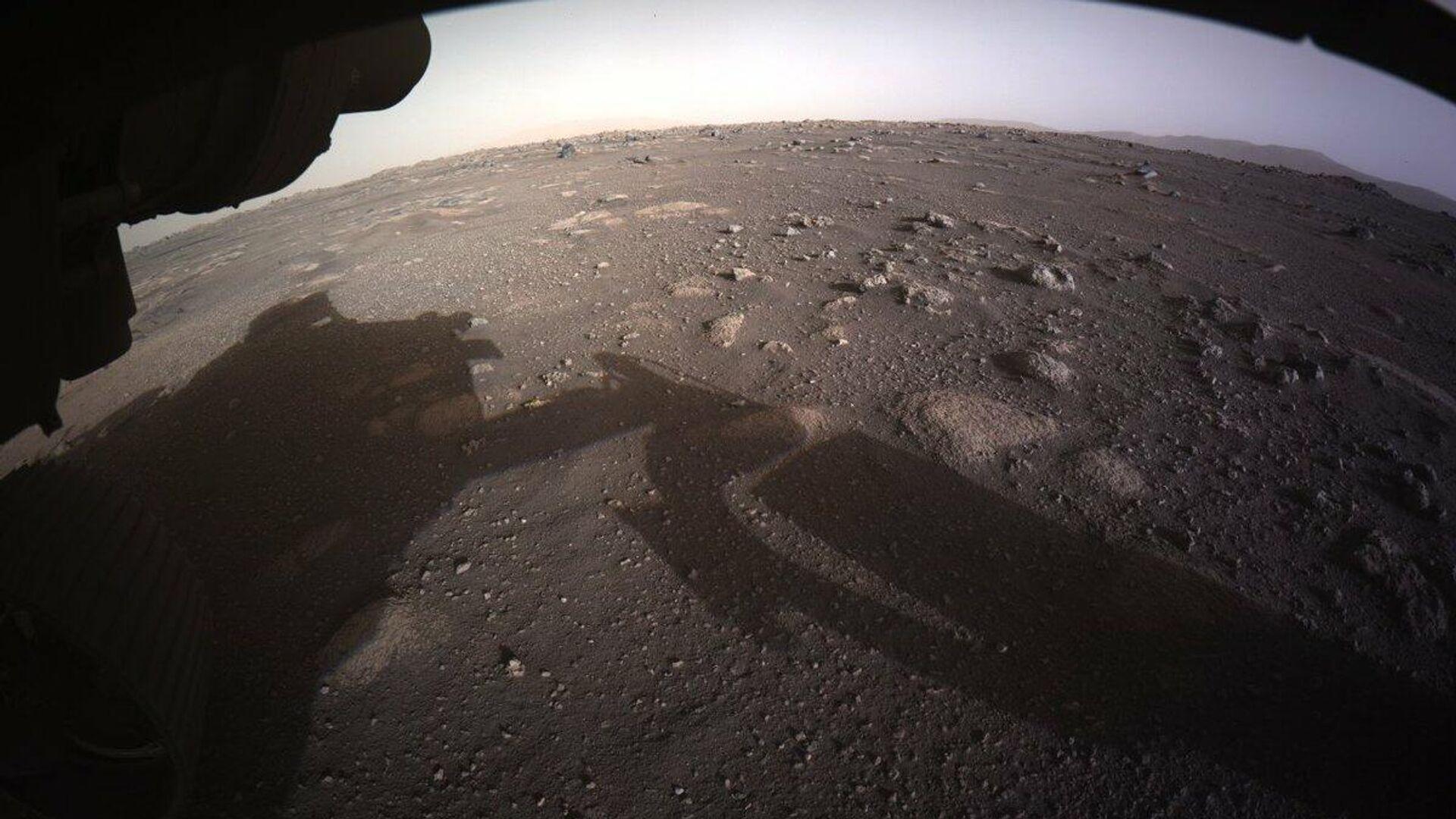 Фотографии, снятые исследовательским аппаратом NASA's Perseverance Mars Rover, который совершил посадку на Марсе в ночь на 19 февраля - РИА Новости, 1920, 20.02.2021