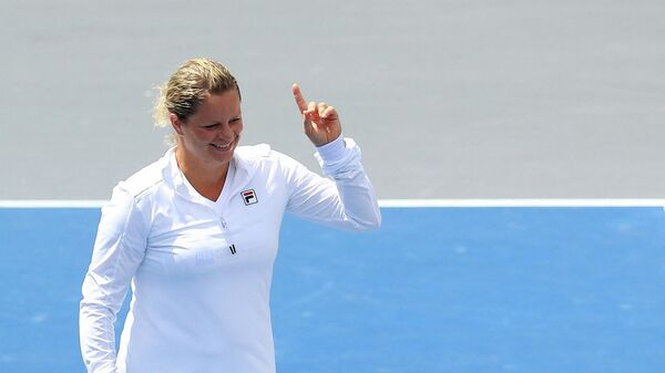 WHITE SULPHUR SPRINGS, WEST VIRGINIA - AUGUST 02: Kim Clijsters of the New York Empire reacts during the finals of the World TeamTennis at The Greenbrier on August 02, 2020 in White Sulphur Springs, West Virginia.   Streeter Lecka/Getty Images/AFP (Photo by STREETER LECKA / GETTY IMAGES NORTH AMERICA / Getty Images via AFP)