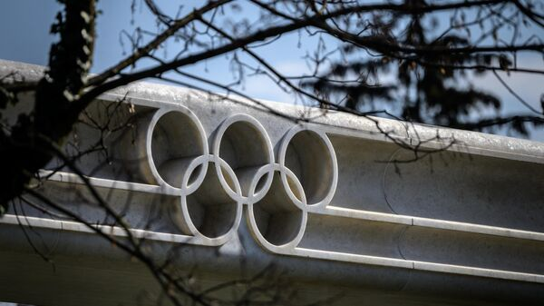 A picture taken on March 8, 2021 in Lausanne shows the Olympic rings next to the headquarters of the International Olympic Committee (IOC) ahead of a session of the World's sport governing body held virtually. (Photo by Fabrice COFFRINI / AFP)