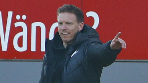 Leipzig's German headcoach Julian Nagelsmann gestures during the German first division Bundesliga football match between SC Freiburg and RB Leipzig in Freiburg, southwestern Germany, on March 6, 2021. (Photo by Ralph ORLOWSKI / POOL / AFP) / DFL REGULATIONS PROHIBIT ANY USE OF PHOTOGRAPHS AS IMAGE SEQUENCES AND/OR QUASI-VIDEO