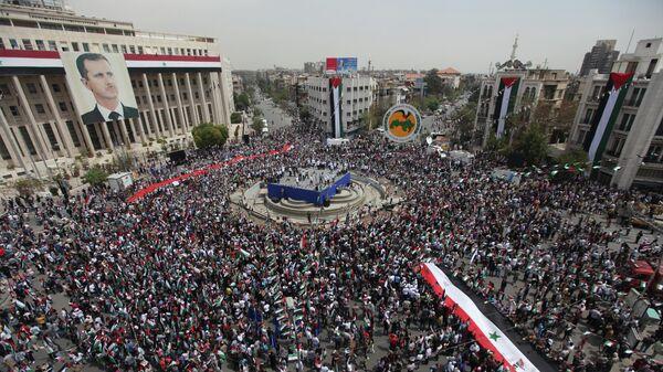 Митинг в поддержку президента Сирии Башара Асада в центре Дамаска