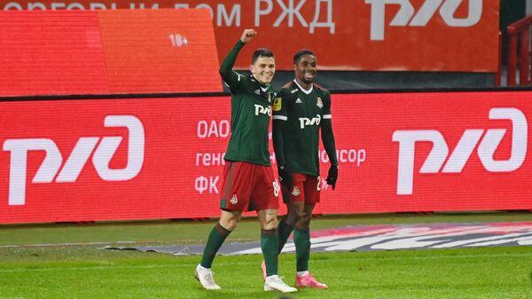 Игроки Локомотива Виталий Лисакович (слева) и Франсуа Камано