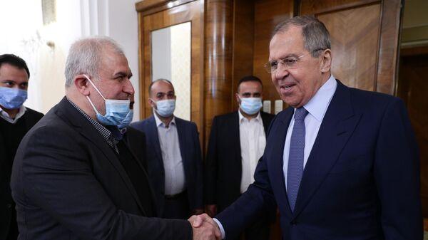 Министр иностранных дел РФ Сергей Лавров и руководитель фракции движения Хизбалла Мухаммед Раад во время встречи в Москве