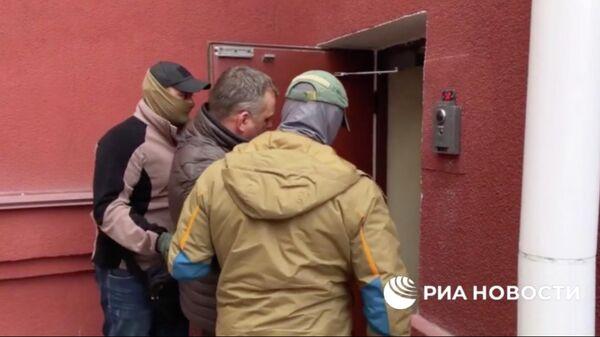 Задержание гражданина России, работающего на спецслужбы Украины. Кадр из оперативного видео ФСБ