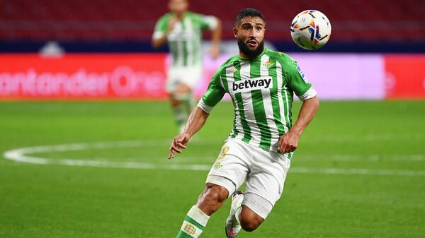 Real Betis' French midfielder Nabil Fekir controls the ball during the Spanish League football match between Atletico Madrid and Real Betis at the Wanda Metropolitan stadium in Madrid on October 24, 2020. (Photo by GABRIEL BOUYS / AFP)