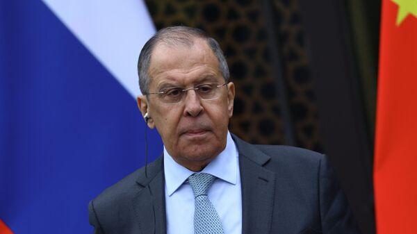 Министр иностранных дел РФ Сергей Лавров во время пресс-конференции после окончания встречи с министром иностранных дел КНР Ван И в Гуйлине