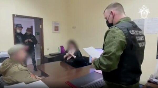 Задержанные за вербовку в организацию Свидетели Иеговы* в Сочи. Кадр видео