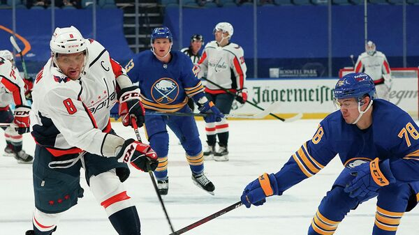 BUFFALO, NY - APRIL 9: Alex Ovechkin #8 of the Washington Capitals takes a shot as Jacob Bryson #78 of the Buffalo Sabres defends during the first period at KeyBank Center on April 9, 2021 in Buffalo, New York.   Kevin Hoffman/Getty Images/AFP (Photo by Kevin Hoffman / GETTY IMAGES NORTH AMERICA / Getty Images via AFP)