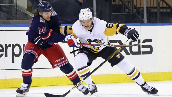 Apr 8, 2021; New York, New York, USA; Pittsburgh Penguins defenseman John Marino (6) plays for the puck against New York Rangers left wing Artemi Panarin (10) during the first period at Madison Square Garden. Mandatory Credit:  Bruce Bennett/Pool Photo-USA TODAY Sports