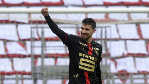 Rennes' French forward Martin Terrier reacts after scoring during the French L1 football match between Stade Rennais (Rennes) and FC Nantes at The Roazhon Park Stadium in Rennes, north-western France on April 11, 2021. (Photo by JEAN-FRANCOIS MONIER / AFP)