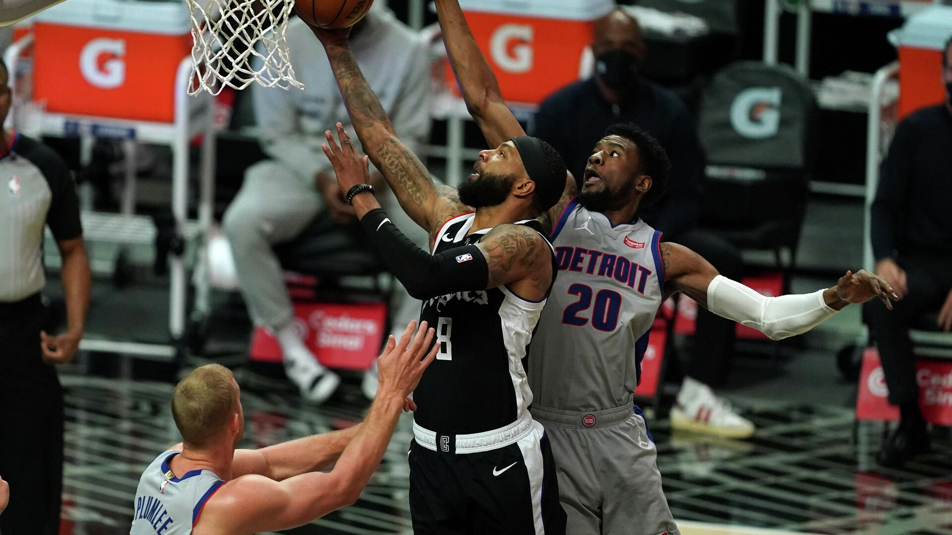 Apr 11, 2021; Los Angeles, California, USA; LA Clippers forward Marcus Morris Sr. (8) is defended by Detroit Pistons guard Josh Jackson (20) and center Mason Plumlee (24)  in the first half at Staples Center. Mandatory Credit: Kirby Lee-USA TODAY Sports - РИА Новости, 1920, 12.04.2021