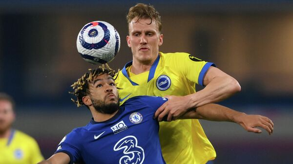 Chelsea's English defender Reece James (L) vies with Brighton's English defender Dan Burn during the English Premier League football match between Chelsea and Brighton and Hove Albion at Stamford Bridge in London on April 20, 2021. (Photo by Mike Hewitt / POOL / AFP) / RESTRICTED TO EDITORIAL USE. No use with unauthorized audio, video, data, fixture lists, club/league logos or 'live' services. Online in-match use limited to 120 images. An additional 40 images may be used in extra time. No video emulation. Social media in-match use limited to 120 images. An additional 40 images may be used in extra time. No use in betting publications, games or single club/league/player publications. /
