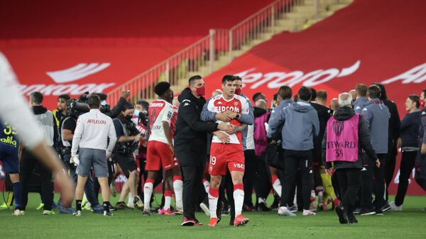 Players argue at the end of the L1 football match between Monaco (ASM) and Lyon (OL) at The Louis II Stadium, in Monaco on May 2, 2021. (Photo by Valery HACHE / AFP)