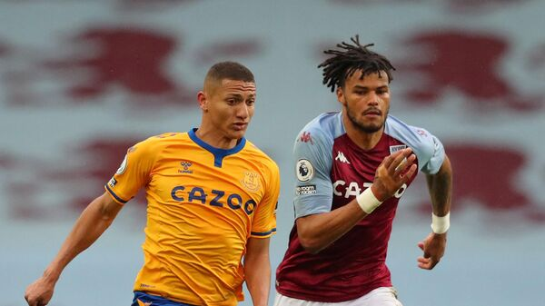 Aston Villa's English defender Tyrone Mings (R) vies with Everton's Brazilian striker Richarlison during the English Premier League football match between Aston Villa and Everton at Villa Park in Birmingham, central England on May 13, 2021. (Photo by Alex Livesey / POOL / AFP) / RESTRICTED TO EDITORIAL USE. No use with unauthorized audio, video, data, fixture lists, club/league logos or 'live' services. Online in-match use limited to 120 images. An additional 40 images may be used in extra time. No video emulation. Social media in-match use limited to 120 images. An additional 40 images may be used in extra time. No use in betting publications, games or single club/league/player publications. /