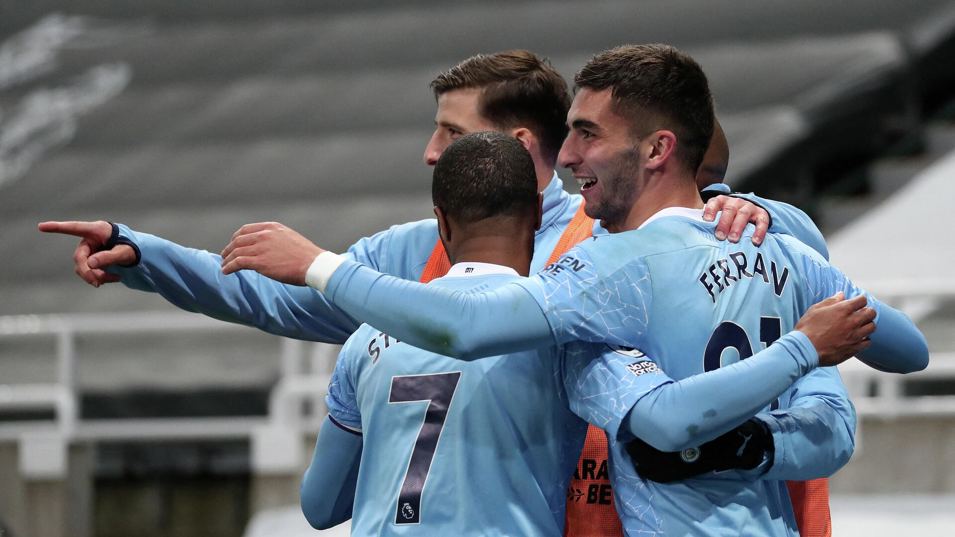 Manchester City's Spanish midfielder Ferran Torres (R) celebrates scoring his team's fourth goal, his third, during the English Premier League football match between Newcastle United and Manchester City at St James' Park in Newcastle-upon-Tyne, north east England on May 14, 2021. (Photo by SCOTT HEPPELL / POOL / AFP) / RESTRICTED TO EDITORIAL USE. No use with unauthorized audio, video, data, fixture lists, club/league logos or 'live' services. Online in-match use limited to 120 images. An additional 40 images may be used in extra time. No video emulation. Social media in-match use limited to 120 images. An additional 40 images may be used in extra time. No use in betting publications, games or single club/league/player publications. /  - РИА Новости, 1920, 15.05.2021