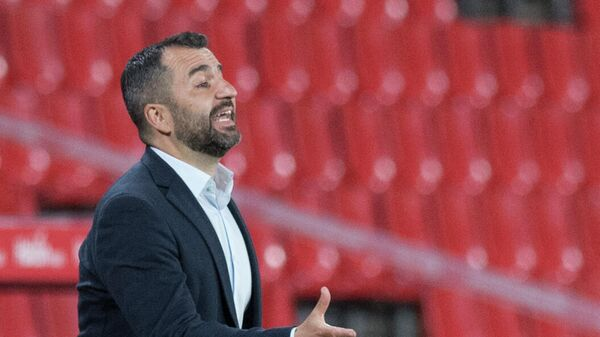 Granada's Spanish coach Diego Martinez Penas gestures during the Spanish league football match Granada FC against Real Madrid CF at the Nuevo Los Carmenes stadium in Granada on May 13, 2021. (Photo by JORGE GUERRERO / AFP)