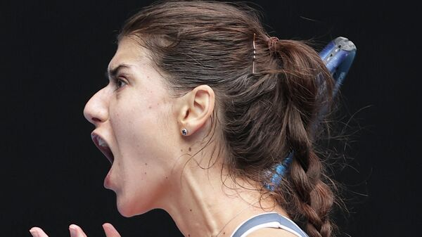 Romania's Sorana Cirstea reacts as she plays against Czech Republic's Marketa Vondrousova during their women's singles match on day five of the Australian Open tennis tournament in Melbourne on February 12, 2021. (Photo by David Gray / AFP) / -- IMAGE RESTRICTED TO EDITORIAL USE - STRICTLY NO COMMERCIAL USE --