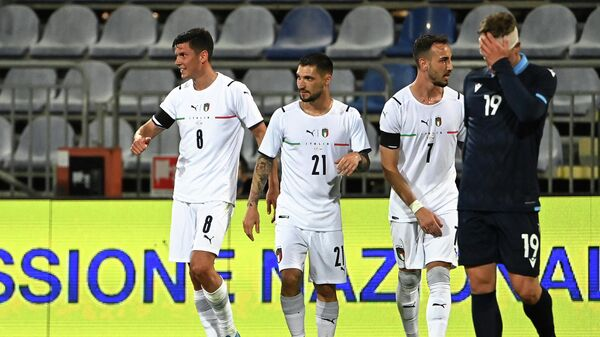 Italy's midfielder Matteo Pessina (L) celebrates with teammates after scoring a goal during a friendly football match between Italy and San Marino at the Sardegna Arena in Cagliari on May 28, 2021, in preparation for the UEFA Euro 2020 European Football Championship. (Photo by ANDREAS SOLARO / AFP)
