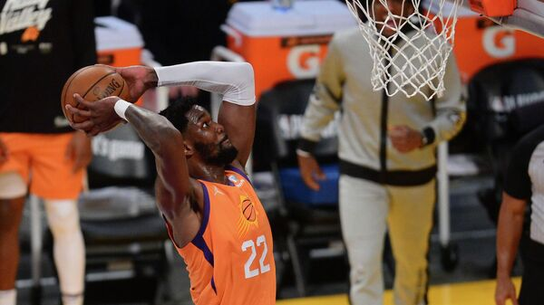May 30, 2021; Los Angeles, California, USA; Phoenix Suns center Deandre Ayton (22) dunks for a basket against the Los Angeles Lakers during the second half in game four of the first round of the 2021 NBA Playoffs. at Staples Center. Mandatory Credit: Gary A. Vasquez-USA TODAY Sports
