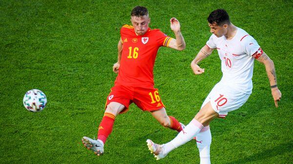 Игровой момент матча сборных Уэльса и Швейцарии на ЕВРО-2020