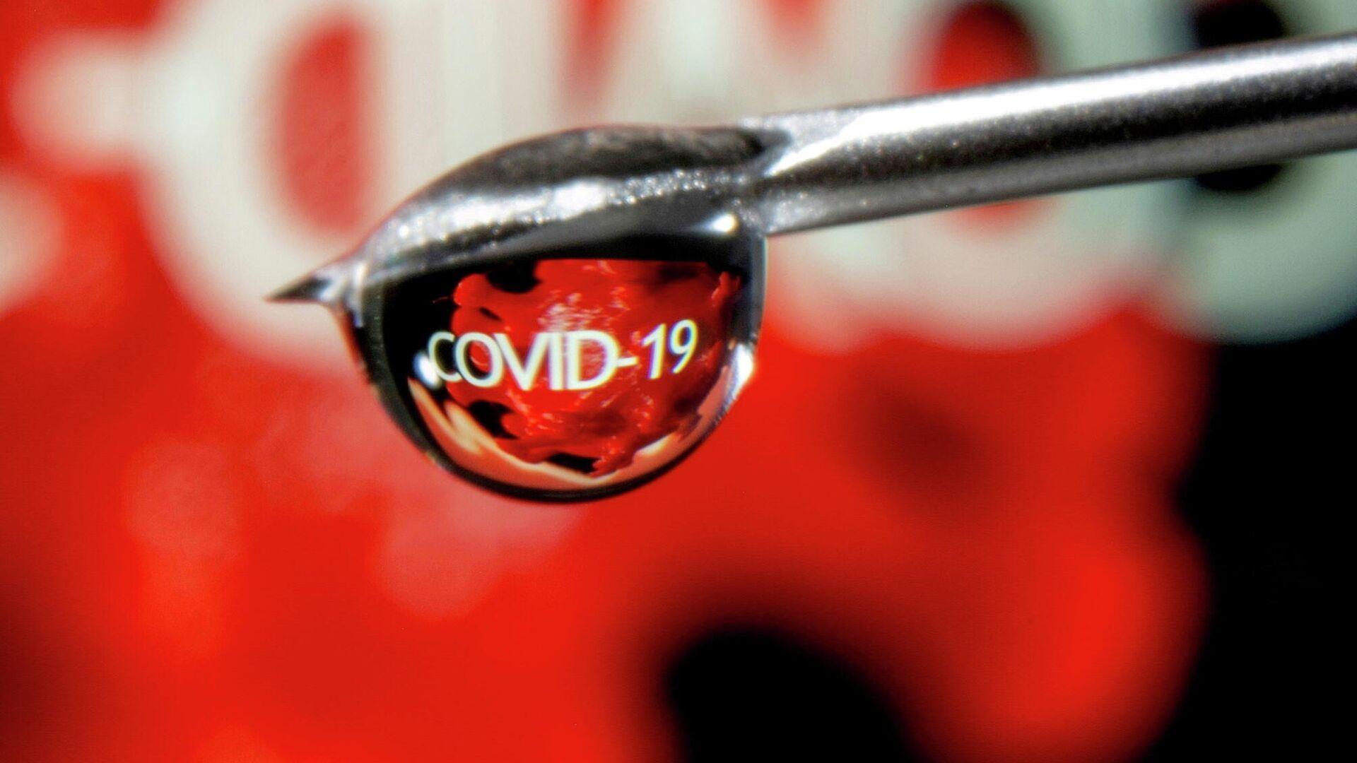 Слово COVID-19 в капле на игле шприца - РИА Новости, 1920, 02.07.2021