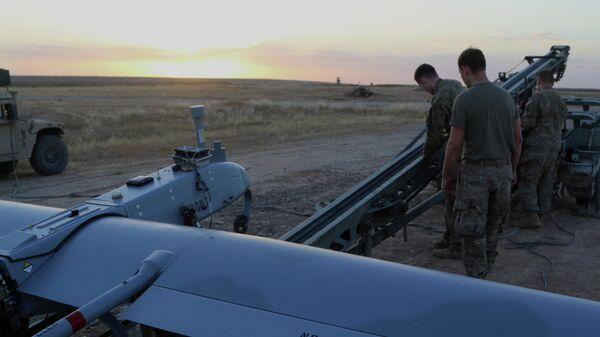 Американские военные запускают беспилотный летательный аппарат на западе Ирака
