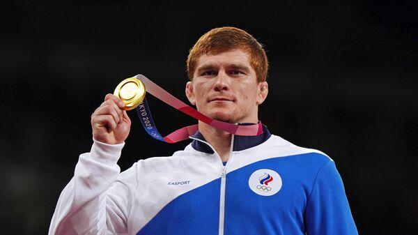 Муса Евлоев, завоевавший золотую медаль на соревнованиях по греко-римской борьбе среди мужчин в весовой категории до 97 кг на XXXII Олимпийских играх в Токио