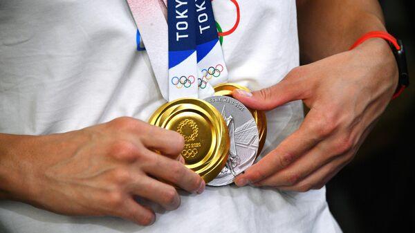 Медали российского пловца Евгения Рылова