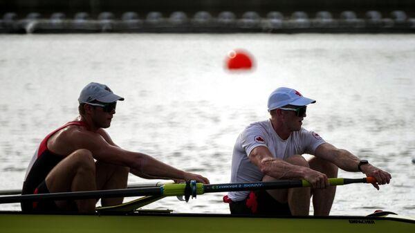 Тренировки спортсменов перед соревнованиями по академической гребле на XXXII летних Олимпийских играх в Токио.
