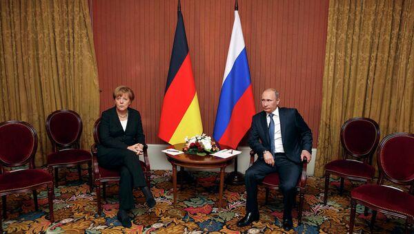 Президент РФ Владимир Путин и канцлер ФРГ Ангела Меркель