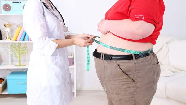 Пациент с избыточным весом. Архивное фото.
