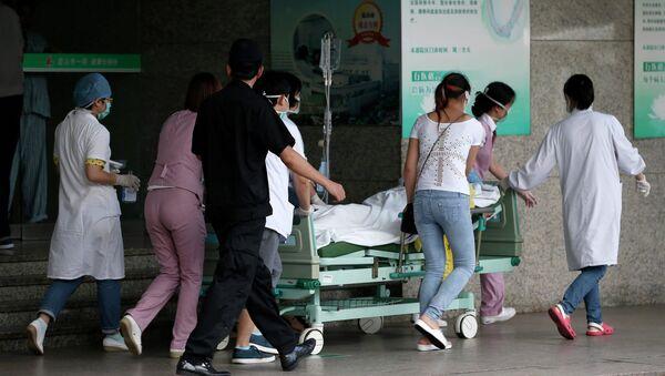 Пострадавшие при взрыве на заводе в Китае 2 августа 2014