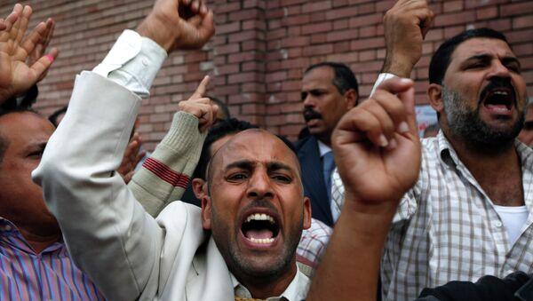 Сторонники Братьев мусульман во время парламентских выборов в Александрии, Египет. Архивное фото