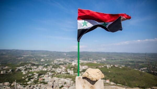 Флаг Сирии над крепостью Крак де Шевалье. Архивное фото