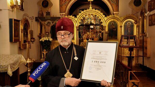 Архиепископ Брюссельский и Бельгийский Симон передает пожертвования жителям Донбасса