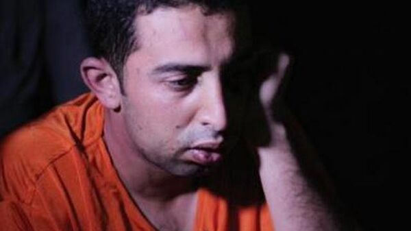 Лейтенант ВВС Иордании Муаз Аль-Касасбех в плену у ИГ