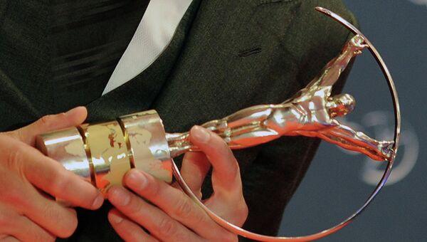 Статуэтка спортивной премии Laureus World Sports Awards