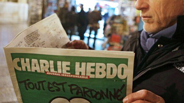 Первый после теракта номер номер французского сатирического еженедельника Charlie Hebdo. Архивное фото