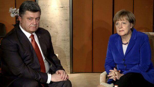 16 октября 2014 года. Президент Украины Петр Порошенко на встрече с канцлером Германии Ангелой Меркель в рамках своего визита на саммит ASEM в Милане