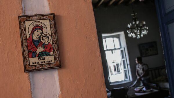 Христианская икона в одном из домов, освобожденных от боевиков, Сирия. Архивное фото