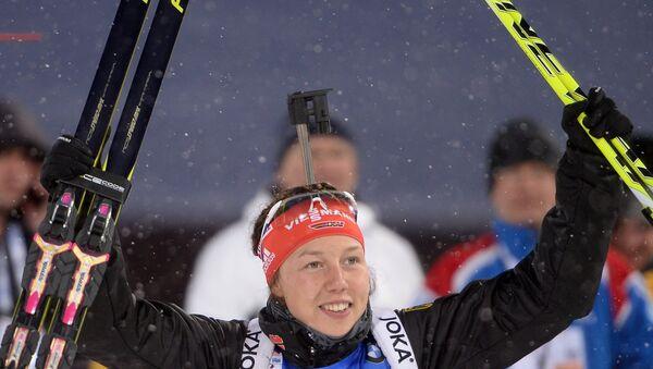 Немецкая биатлонистка Лаура Дальмайер на девятом этапе Кубка мира по биатлону сезона 2014/15 в городе Ханты-Мансийске.