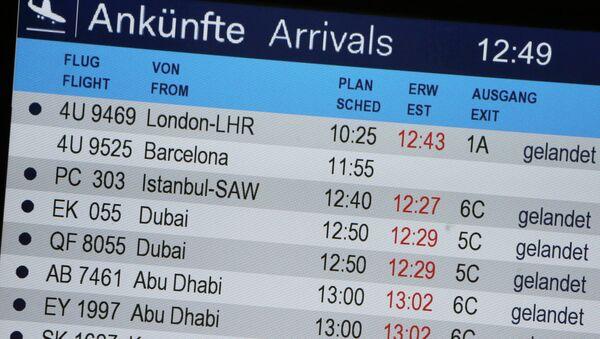Табло прилета в аэропорту Дюссельдорфа, Германия