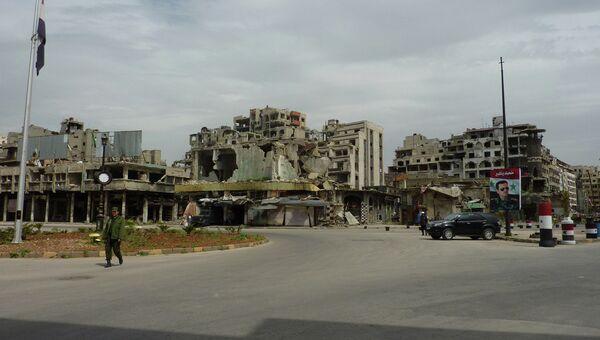 Поврежденные в ходе боев дома в городе Хомс, Сирия. Архивное фото