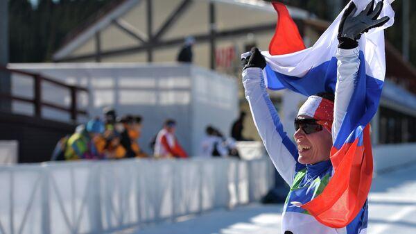 Анна Федулова (Россия) на финише масс-старта среди женщин на XVIII Сурдлимпийских зимних играх в Ханты-Мансийске