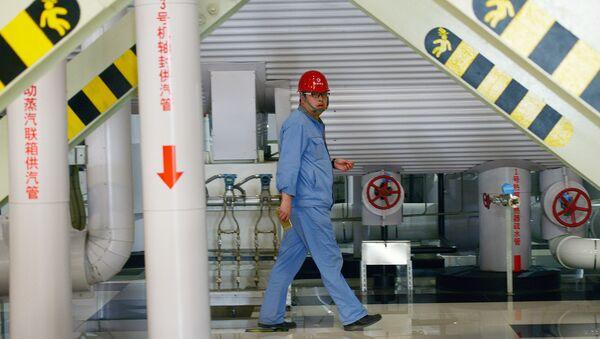 Работник газовой электростанции Пекина, Китай