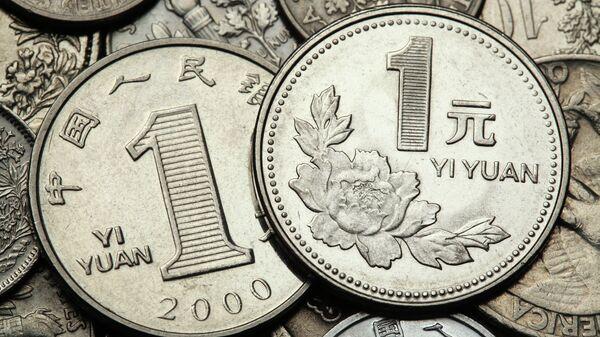 Монеты в 1 юань. Архивное фото