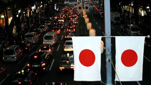 Флаги Японии на улице Токио