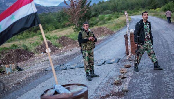 Сирийские военные на блокпосту в провинции Латакия. Архивное фото
