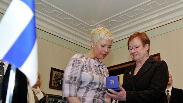 Эвелин Ильвес, президент Финляндии Тарья Халонен и президент Эстонии Тоомас Хендрик Ильвес (слева направо). Архивное фото